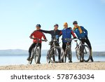 Group Of Cyclists On A Shore O...