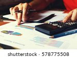 man doing finance and thinking... | Shutterstock . vector #578775508
