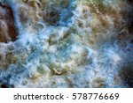 Small photo of In captivity waterfall. Falling and swirling water, streaming and foam on surface of waterfall at different sites, stochastic motion