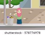 a girl throw a trash into... | Shutterstock .eps vector #578776978
