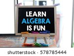 Small photo of A Concept Image of a blackboard with a word LEARN ALGEBRA IS FUN and a small colorful clothespin on a rusty table surface over a blur bright background