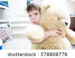 child hugging teddy bear indoor ... | Shutterstock . vector #578808778