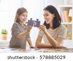happy family. mother and... | Shutterstock . vector #578885029