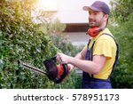 gardener using an hedge clipper ... | Shutterstock . vector #578951173