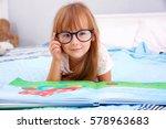 little cute girl reading book | Shutterstock . vector #578963683
