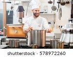 chef cook in uniform cooking... | Shutterstock . vector #578972260
