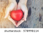 heart in hands on wooden... | Shutterstock . vector #578998114