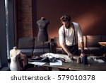 beautiful serious tailor with