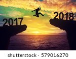 a man jump between 2017 and... | Shutterstock . vector #579016270