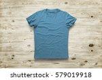 blue shirt over wood background  | Shutterstock . vector #579019918
