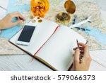 bloger planning budget of trip... | Shutterstock . vector #579066373