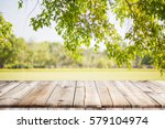 Empty Wooden Table With Garden...