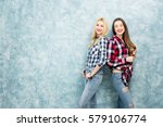 portrait of two female friends... | Shutterstock . vector #579106774