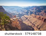 a male hiker is standing on a... | Shutterstock . vector #579148738
