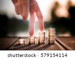 a coins stack with finger | Shutterstock . vector #579154114