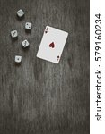 Small photo of playing card ace of hearts and game dice background, vintage abstract, top view, vertical size
