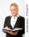 A businesswoman writing in her diary - stock photo