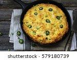 Stock photo jalapeno cornbread made in cast iron skillet on dark wooden background 579180739