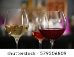 three glasses with tasty wine... | Shutterstock . vector #579206809
