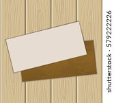 the sheet of paper on a wooden... | Shutterstock .eps vector #579222226