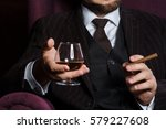 man smoking cigar and drink... | Shutterstock . vector #579227608