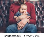 a young father is sitting on a... | Shutterstock . vector #579249148