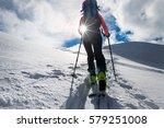 girl mountaineer climb on skis...   Shutterstock . vector #579251008