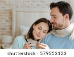 positive couple sitting at home | Shutterstock . vector #579253123
