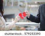 Couple Holding Broken Heart Sa...