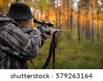 hunter aiming with rifle   Shutterstock . vector #579263164