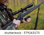 hunter loading rifle | Shutterstock . vector #579263173