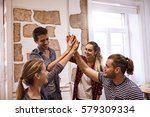 four young people giving each... | Shutterstock . vector #579309334