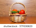 Tomatoes And Peppers In Basket...