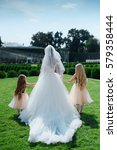 Small photo of The bride accompanied by two little girls