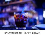 glass of iced cocktail on bar... | Shutterstock . vector #579415624
