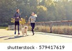 Stock photo fitness sport people and lifestyle concept happy couple with dog running outdoors 579417619