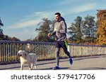 Stock photo fitness sport people pets and lifestyle concept happy man with labrador retriever dog running 579417706