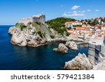 Small photo of DUBROVNIK, CROATIA - JULY 19th, 2016: sea cove and docks guarded by Pile Gate walls and Fort Lovrijenac at Old Town. Adriatic's deep blue waters attract many tourists for the sunny summer season.