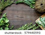 fresh herb frame on dark wooden ... | Shutterstock . vector #579440593