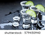 silver tequila shots with ice... | Shutterstock . vector #579450940