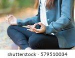 young business woman doing yoga