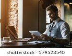 young businessman working on a... | Shutterstock . vector #579523540