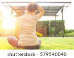 woman stretching the neck... | Shutterstock . vector #579540040