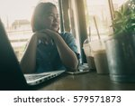 young asian woman looking at... | Shutterstock . vector #579571873