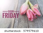 Small photo of Concept vintage color on flower and wooden table with word GOOD FRIDAY