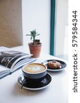 cup of coffee and cookies on a... | Shutterstock . vector #579584344
