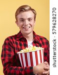 young man with popcorn | Shutterstock . vector #579628270
