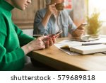 in foreground young... | Shutterstock . vector #579689818
