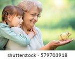grandmother with grandaughter... | Shutterstock . vector #579703918