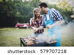 friends having fun grilling... | Shutterstock . vector #579707218